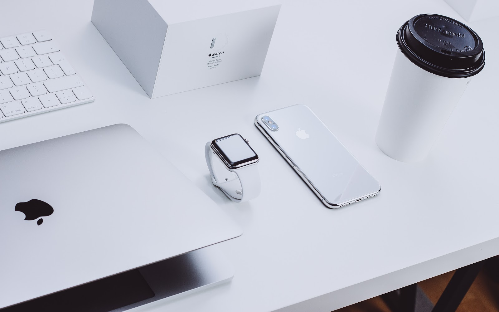 Apple products on a white desk.