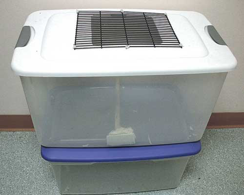 A plastic tub, its top replaced with wire and with a heating pad underneath, makes a practical homecare unit