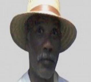 A person wearing a hat  Description automatically generated