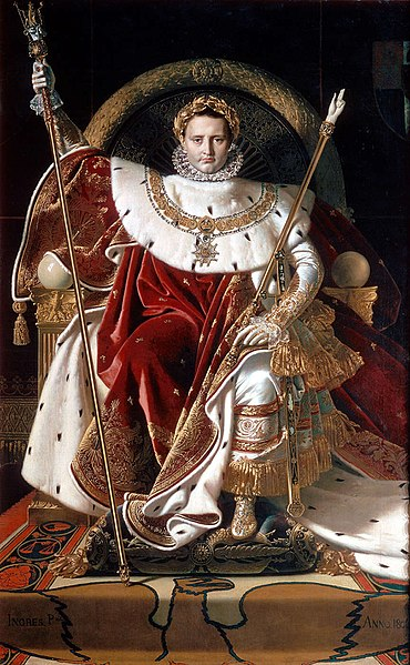 Napoleon in luxurious crimson robes of office holding two jeweled scepters and wearing a golden crown of laurels.