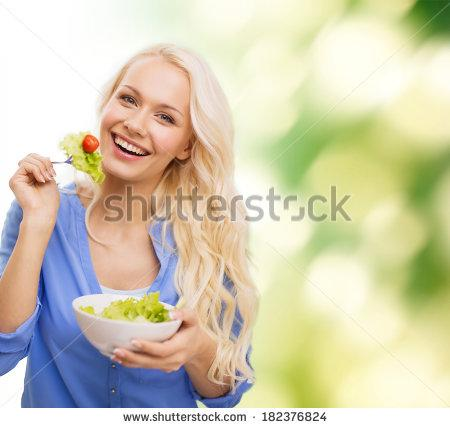 healt, dieting and happiness concept - smiling young woman with green salad