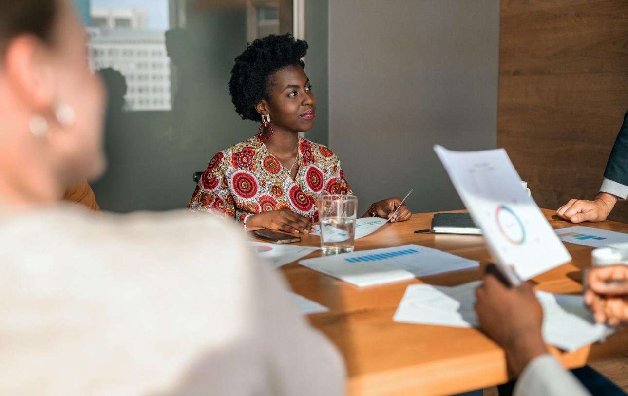 Female entrepreneur in a meeting with coworkers