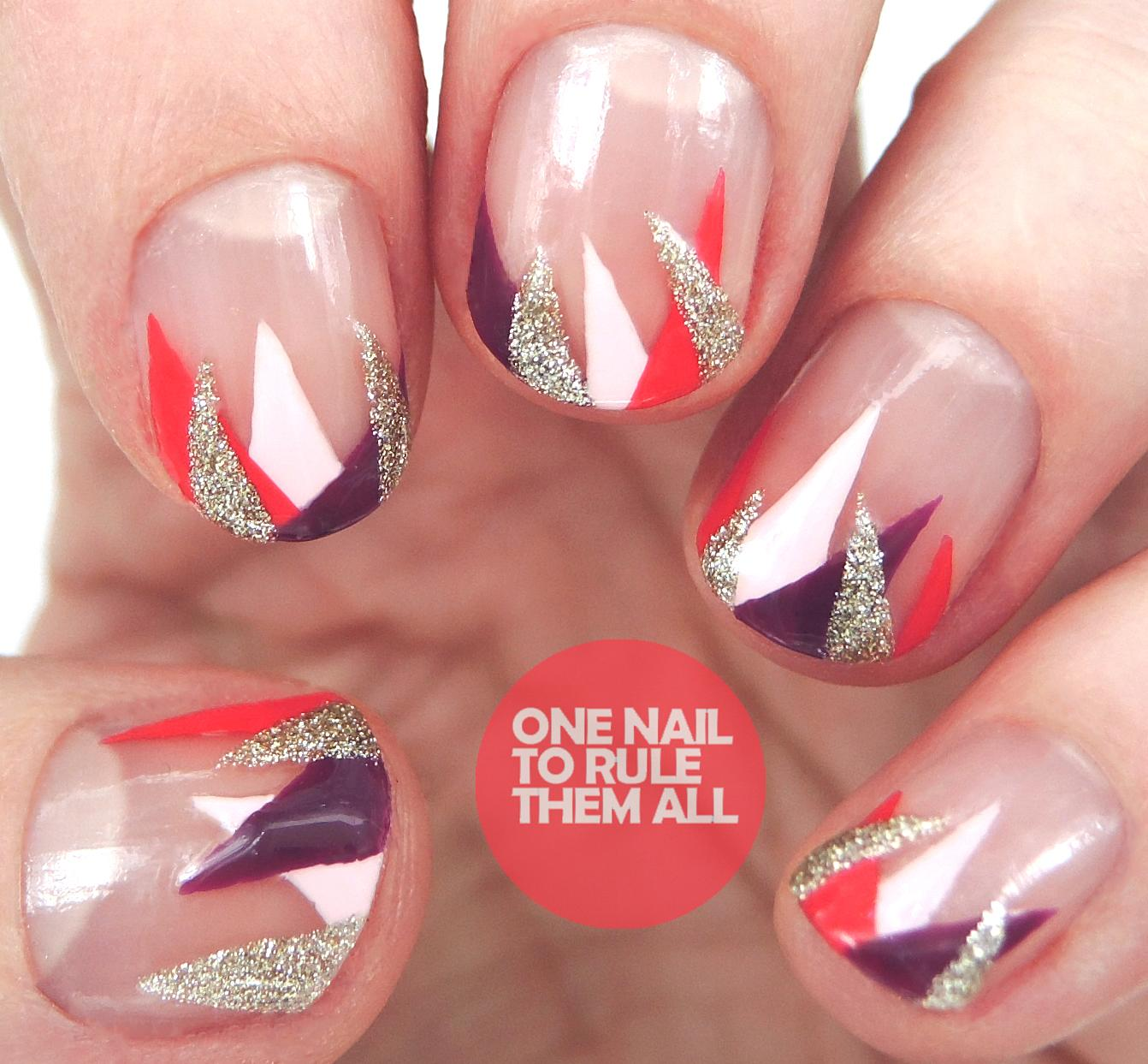 Clear nails featuring triangles of different colors, including gold glitter, white, berry & red