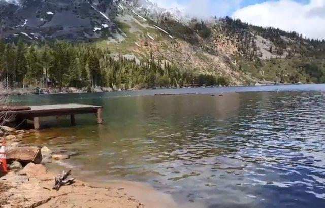A swimming platform juts out from the rocky shore of Fallen Leaf Lake