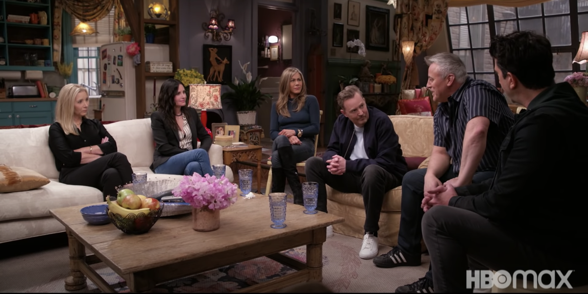 a group of people sitting at a table: The cast, release date, and more details for the 'Friends' reunion on HBO Max.