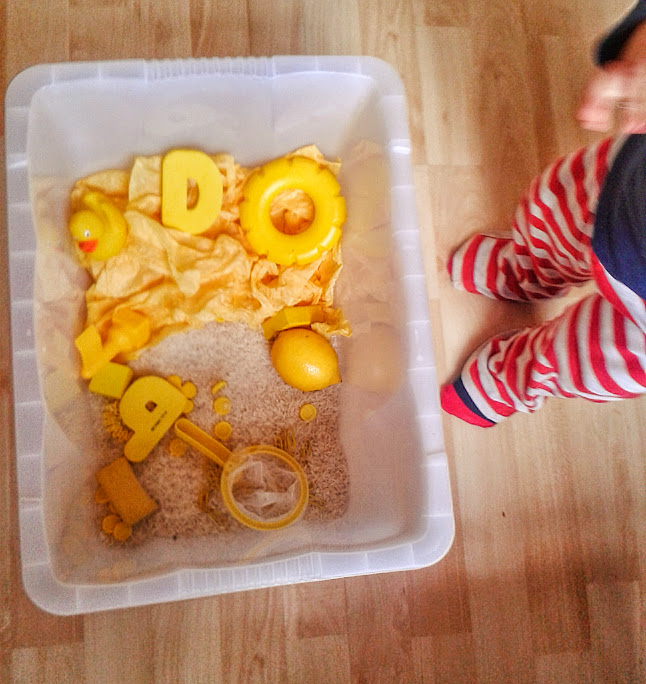 Welcome to Mommyhood: yellow sensory bin