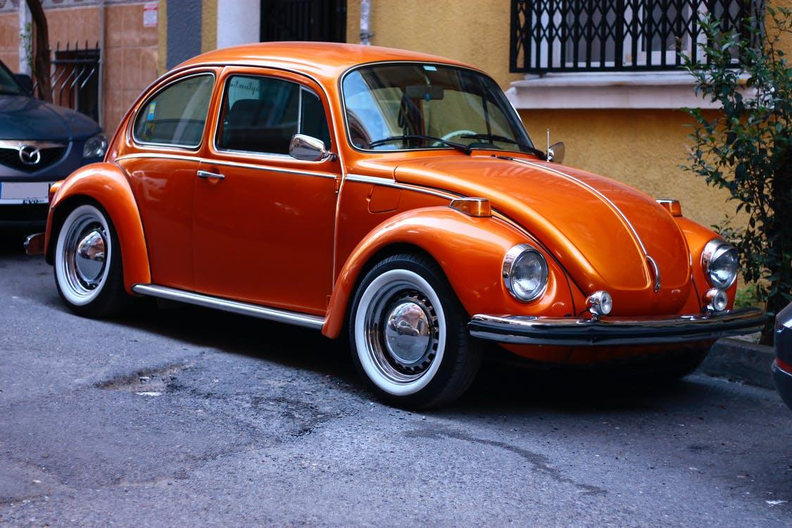An old Volkswagen Beetle project car for sale parked on the side of a road