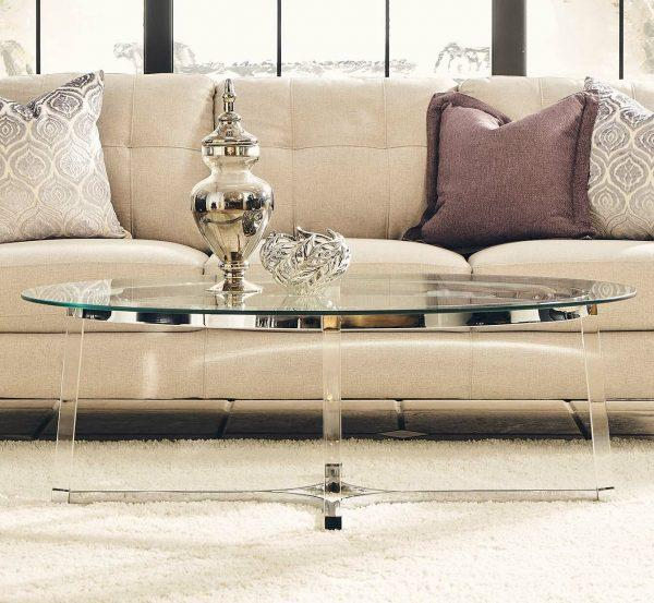 http://cdn.home-designing.com/wp-content/uploads/2021/04/oval-glass-top-coffee-table-with-transparent-acrylic-legs-silver-frame-unique-glamorous-furniture-for-living-room-600x553.jpg