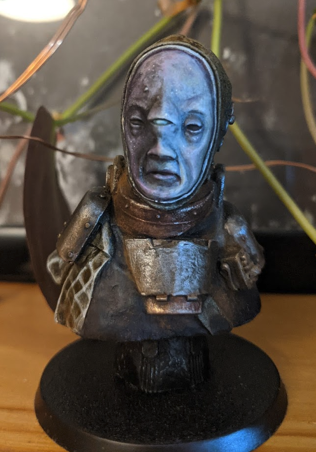 The model bust of a Navigator, a man with pale blue skin and a third eye on the bridge of his nose.