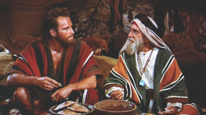 Charlton Heston as Moses (left) and Eduard Franz as Jethro. From The Ten Commandments directed by Cecil B. DeMille. © 1956 Paramount Pictures.