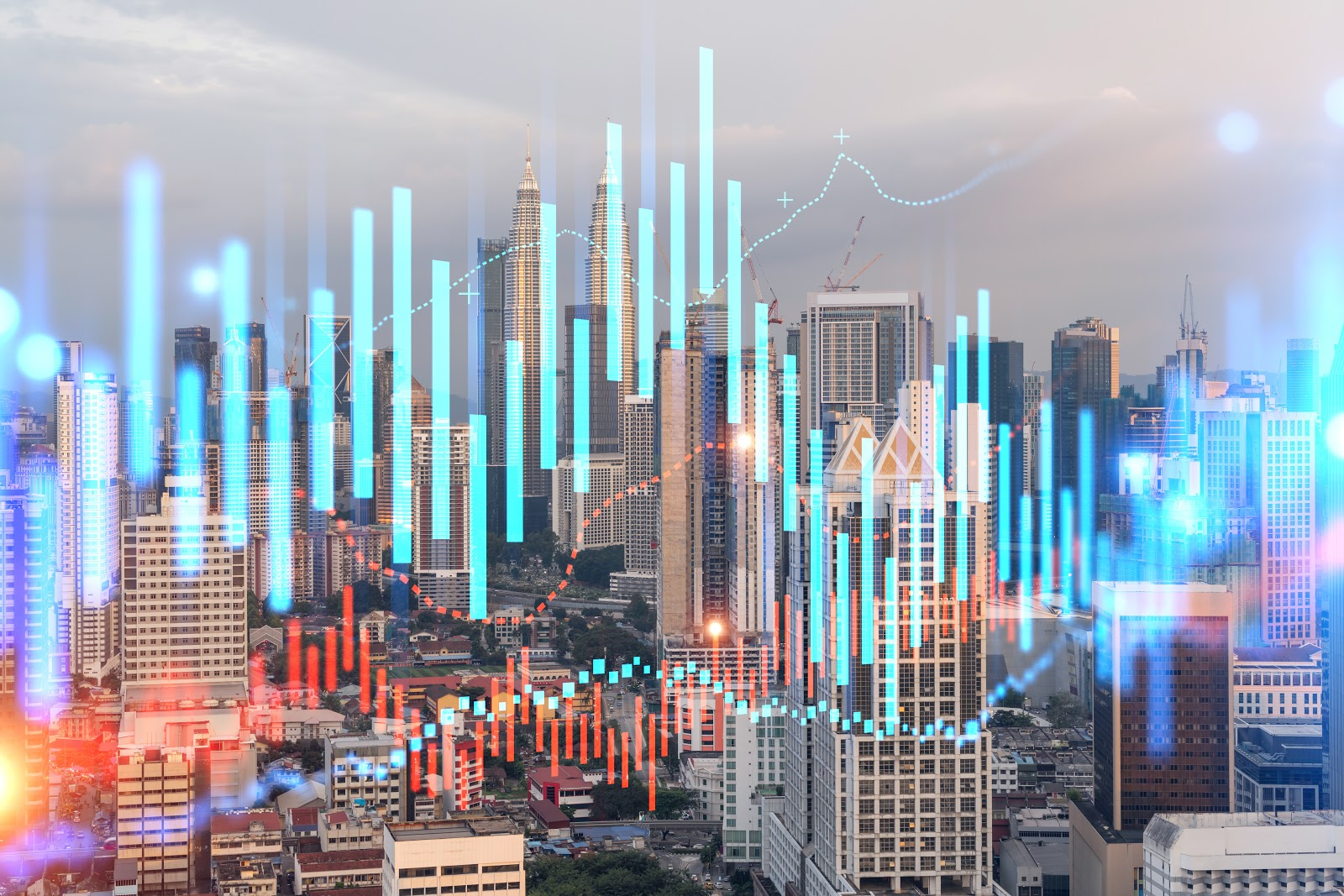 A cityscape with a glowing stock graph over top