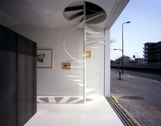 http://www.digsdigs.com/photos/minimalist-spiral-staircase1-554x434.jpg