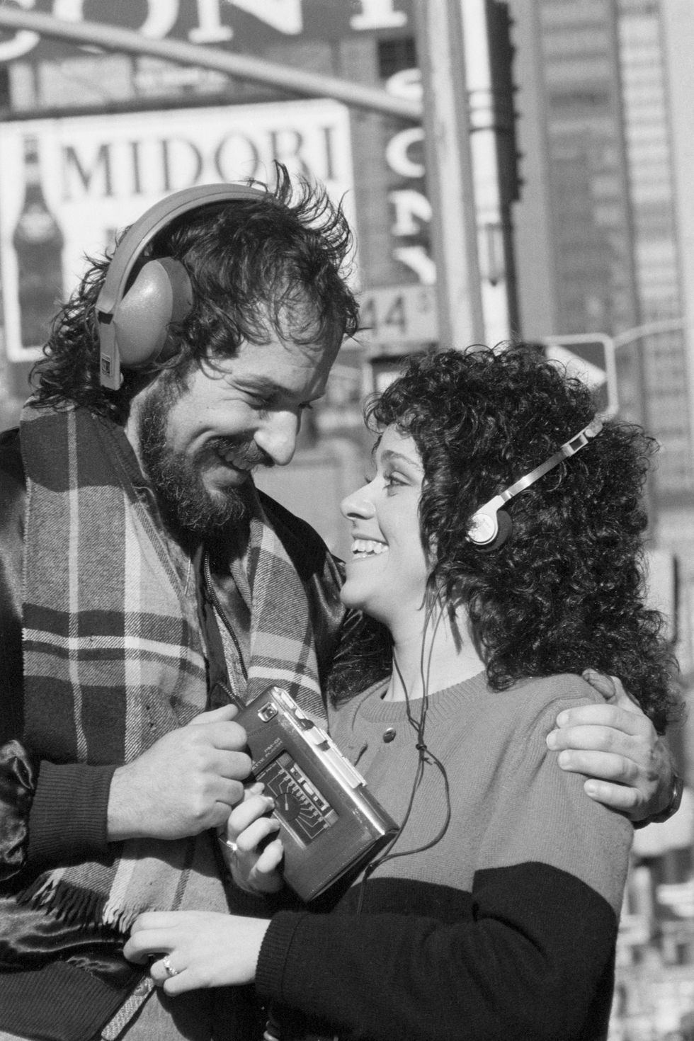 Couple using a Sony Walkman
