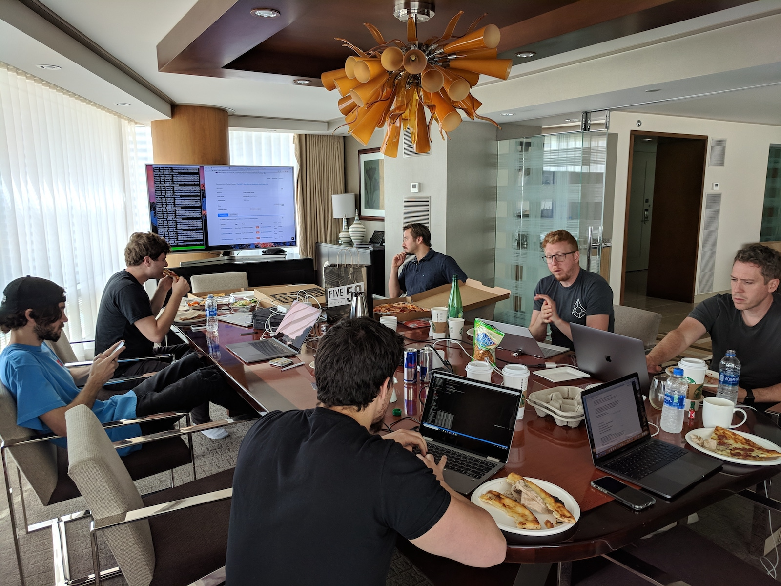 Pizza before launch—which would come much later in the evening. From left to right: Tom Kysar, Joey Krug, Alex Chapman (developer), Jack Peterson, Paul Gebheim, and Scott Bigelow.