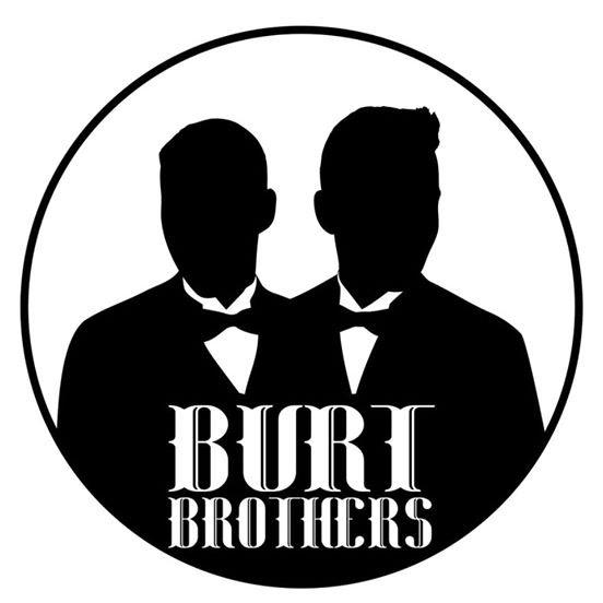 Silhouette of two people in tuxedos