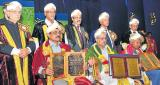 Anand Teltumbde, professor at Indian Institute of Technology, Kharagpur; GHNayak, literary critic; and C P Krishnakumar, writer, were conferred with honorary doctorates during the 14th convocation of Karnataka State Open University, in Mysore, on Saturday. Governor H R Bhardwaj, Vice-Chancellor M G Krishnan, Registrar (Evaluation) K J Suresh, Registrar P S Nayak and others are seen. DH Photo