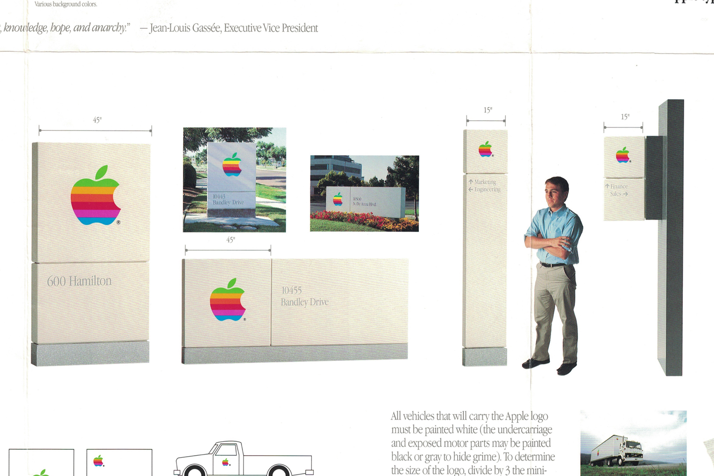 A visual identity system for the Apple logo featuring signage of various sizes.