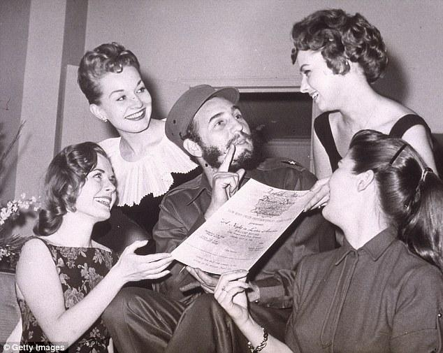 A prodigious womaniser and food connoisseur who kept some 20 luxurious properties throughout the Caribbean — including a private island he used to visit on his beautiful yacht — Castro was a complete fraud. Seen above being presented with an invitation to the New York Press Photographer's Ball, New York City, April 23, 1959