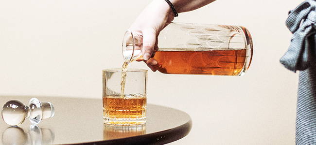 A Smooth Pour From A Decanter For Spirits