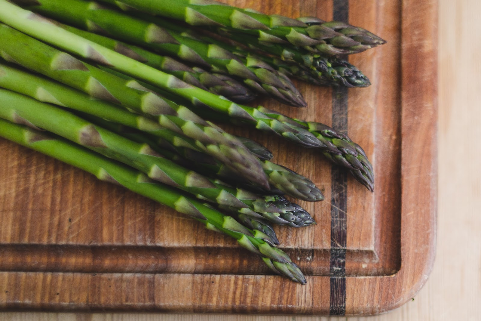 Asparagus on a cutting board.