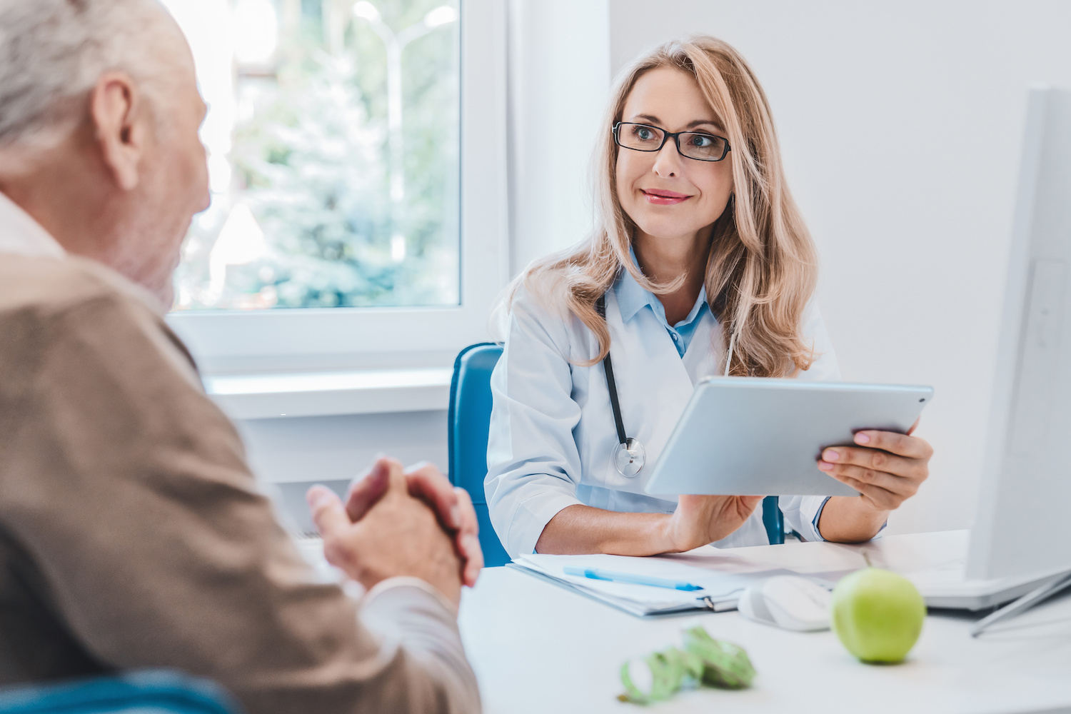 personalized medicine: doctor talking to an elderly patient