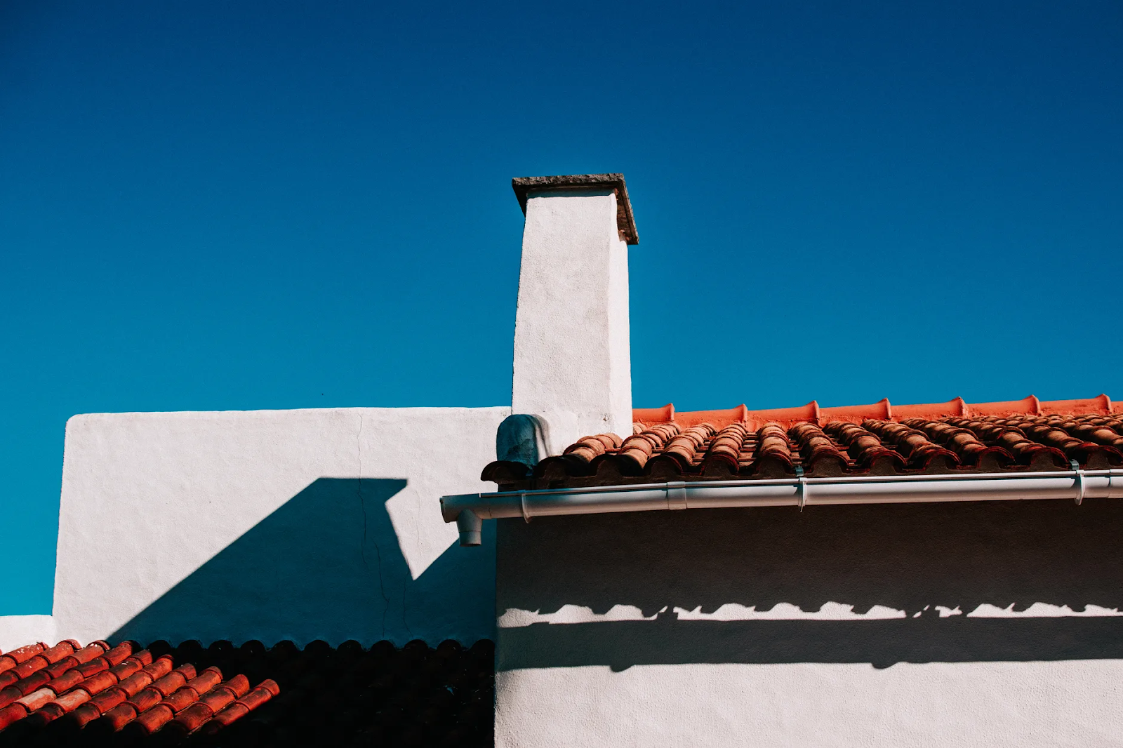 photo of brilliant blue sky and roof of a home