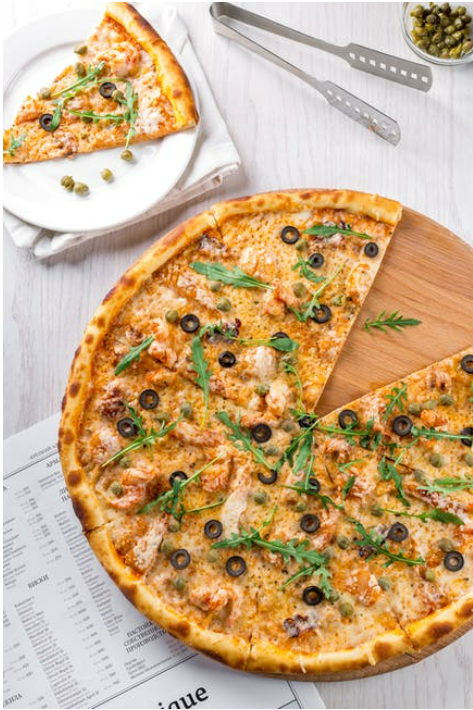 A picture containing pizza, food, table, dish  Description automatically generated