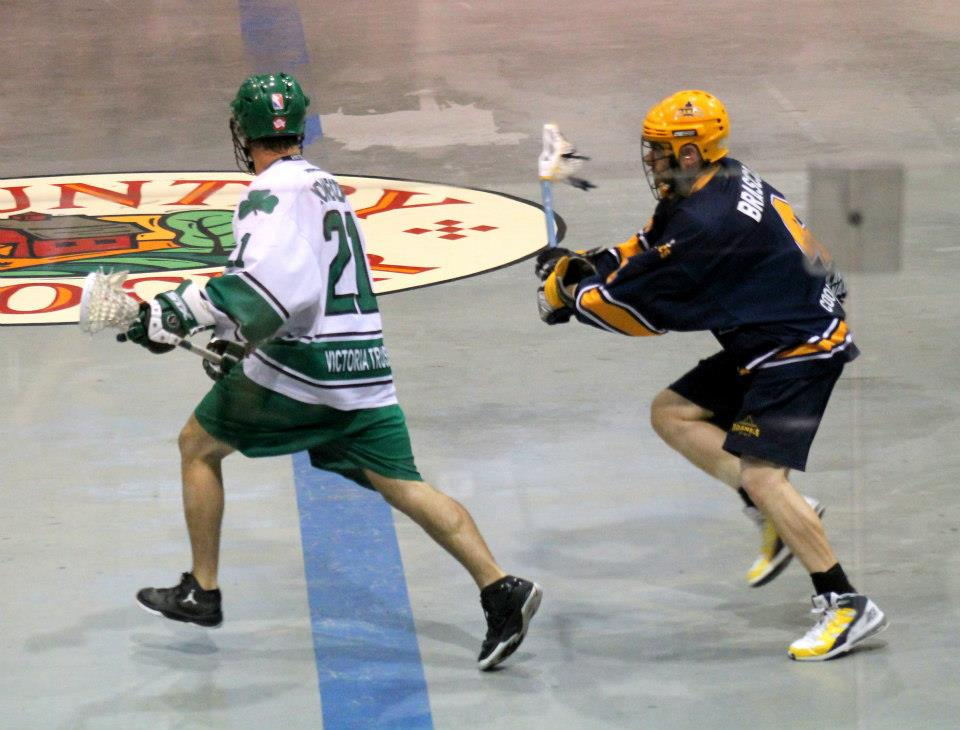 Player using lacrosse dodges to protect the ball, always keeping his body between the ball and the defender