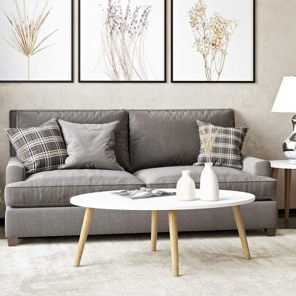 http://cdn.home-designing.com/wp-content/uploads/2021/04/wood-oval-coffee-table-with-white-top-and-light-finish-legs-cheap-Scandinavian-furniture-for-sale-online-600x600.jpg