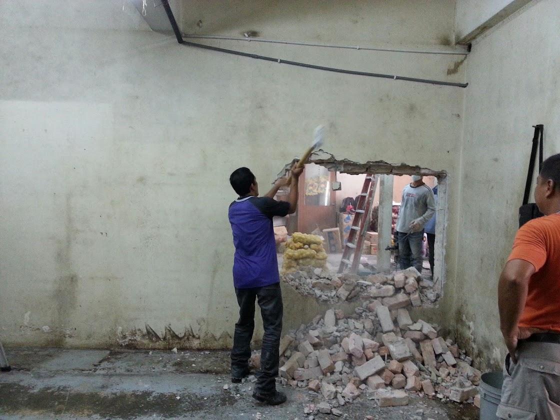 demolish brick wall