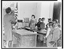 Example image 3: black and white photograph of Mrs. Claire Cumberbatch leading oath of allegiance in a classroom