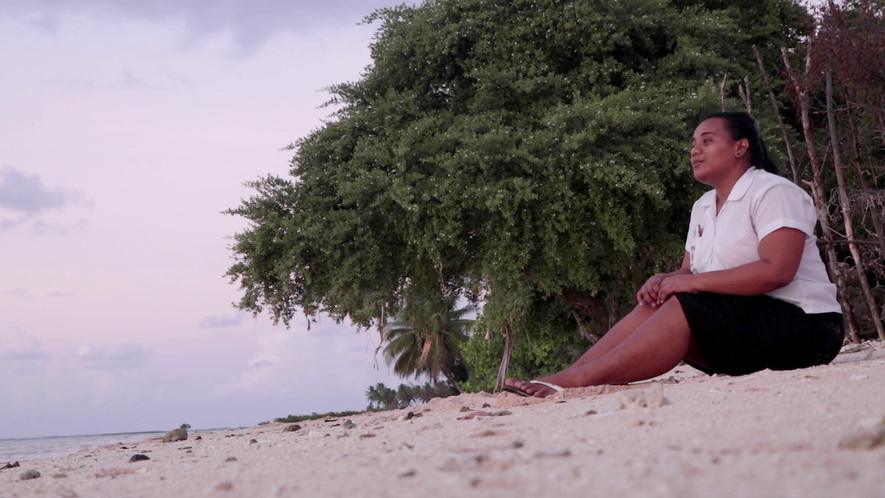 Image 1. Maritina Nakekea, 19, is a resident of Kiribati, a country made up of 33 coral atolls located halfway between Australia and Hawaii. Today Kiribati's existence is threatened by climate change. Photo: Itinnaibo Aukitino/iGeneration Youth