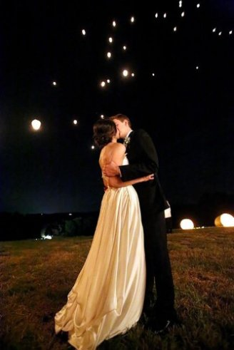 brides kissing each other in a lighted place