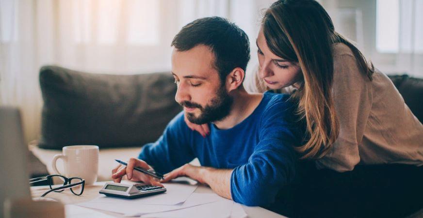 Couple work on budgeting