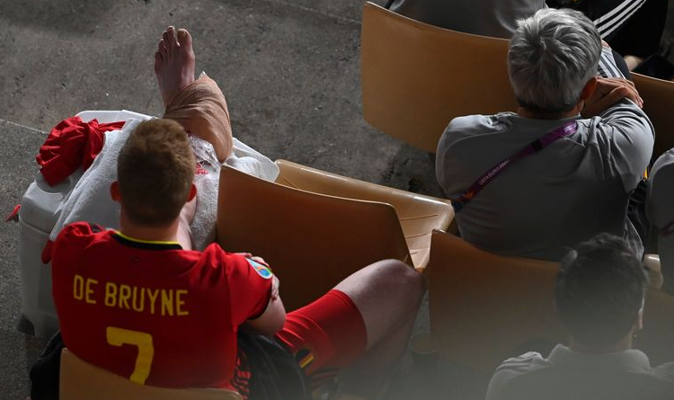 Kevin De Bruyne sat with an ice pack on his ankle after limping off