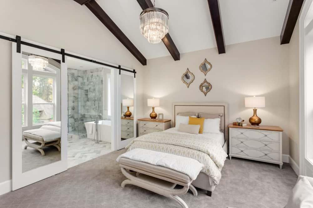 Primary Modern Bedroom with Wood Ceiling Beams