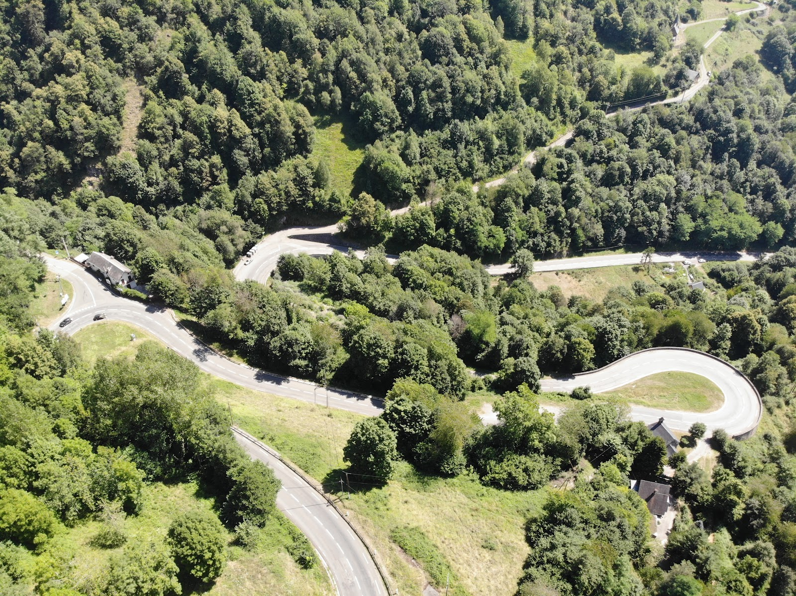 Climbing Col de Peyresourde from Bagneres-de-Luchon by bike - aerial drone photo of hairpin and switchbacks