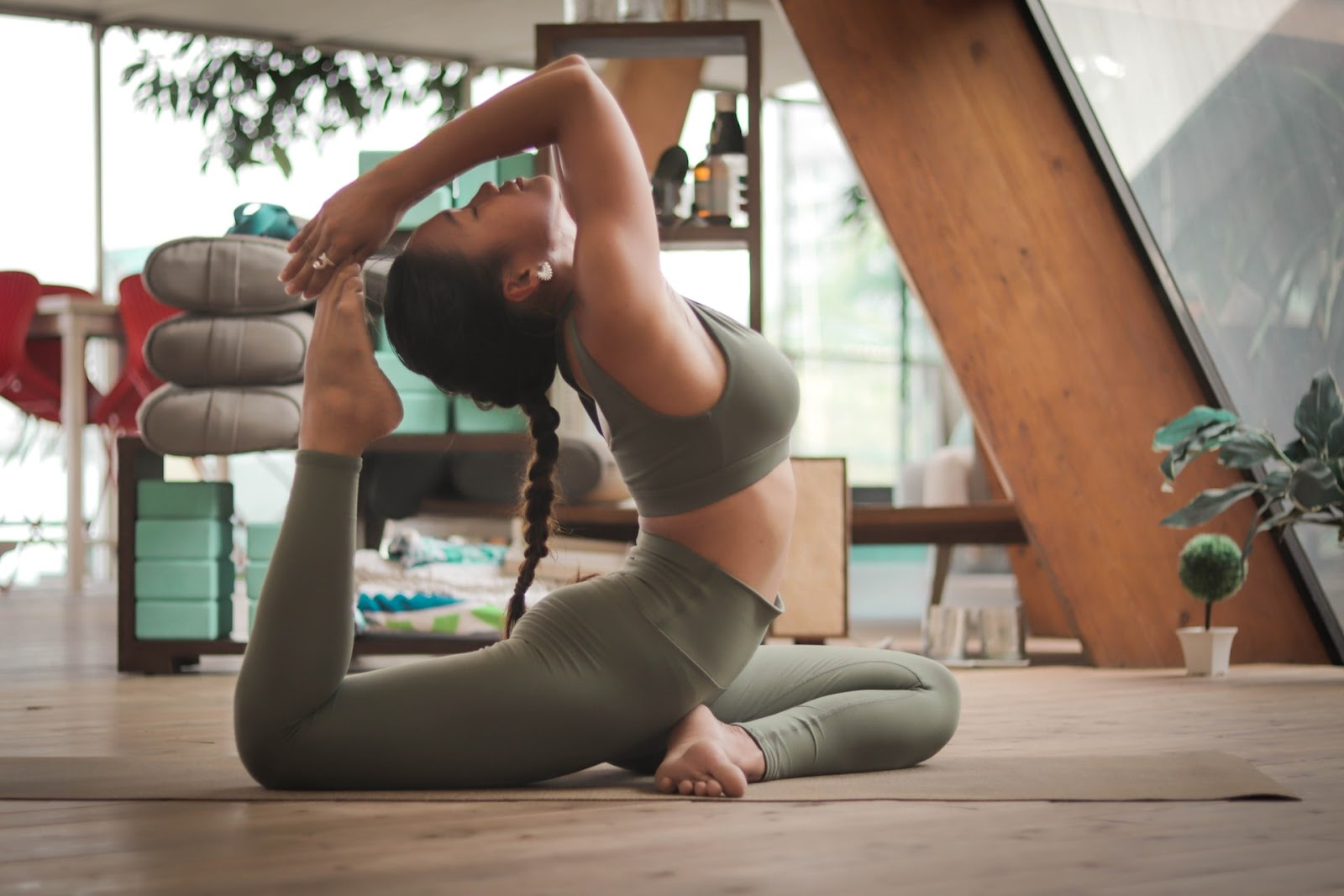 Indoor activities to keep you fit, a girl trying a yoga pose on her mat
