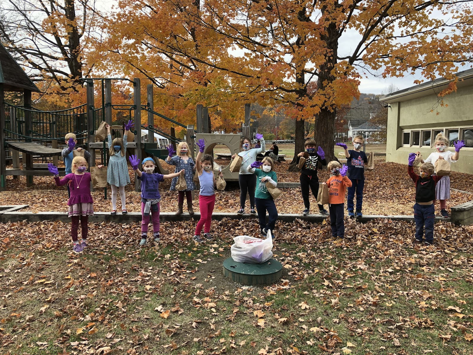 students on the playground for photo op after picking up trash