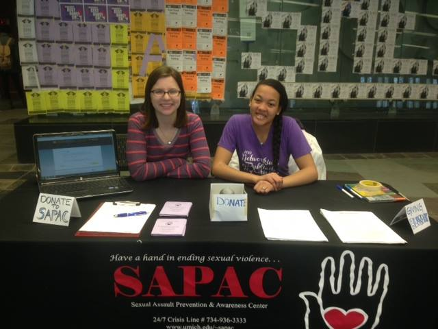 Volunteers tabling an event