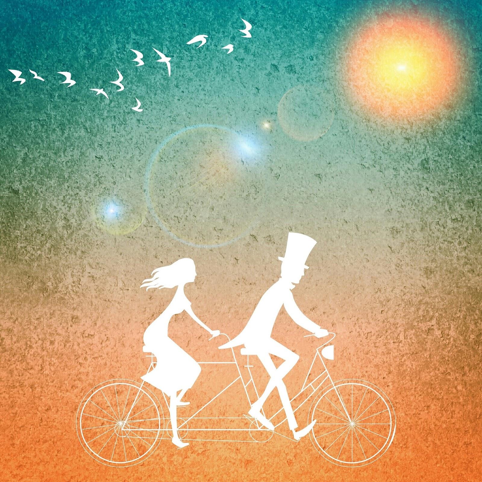 ציור של זוג רוכב על אופניים בשקיעה