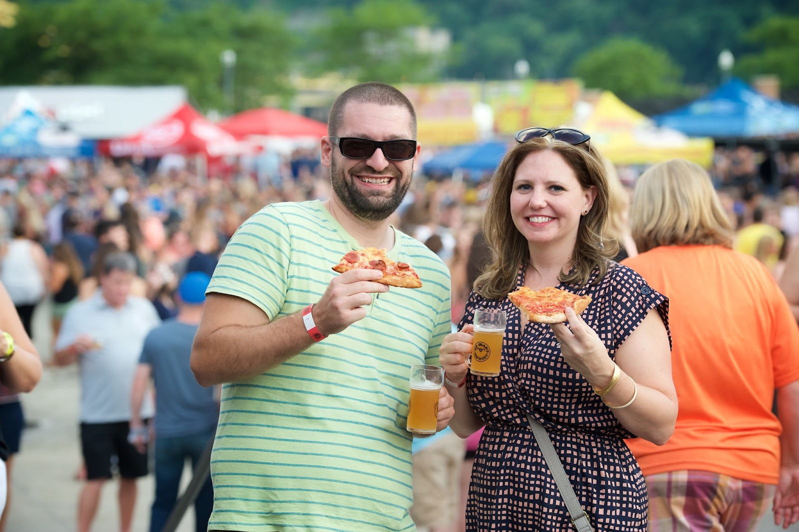 eating pizza and drinking beer at a festival