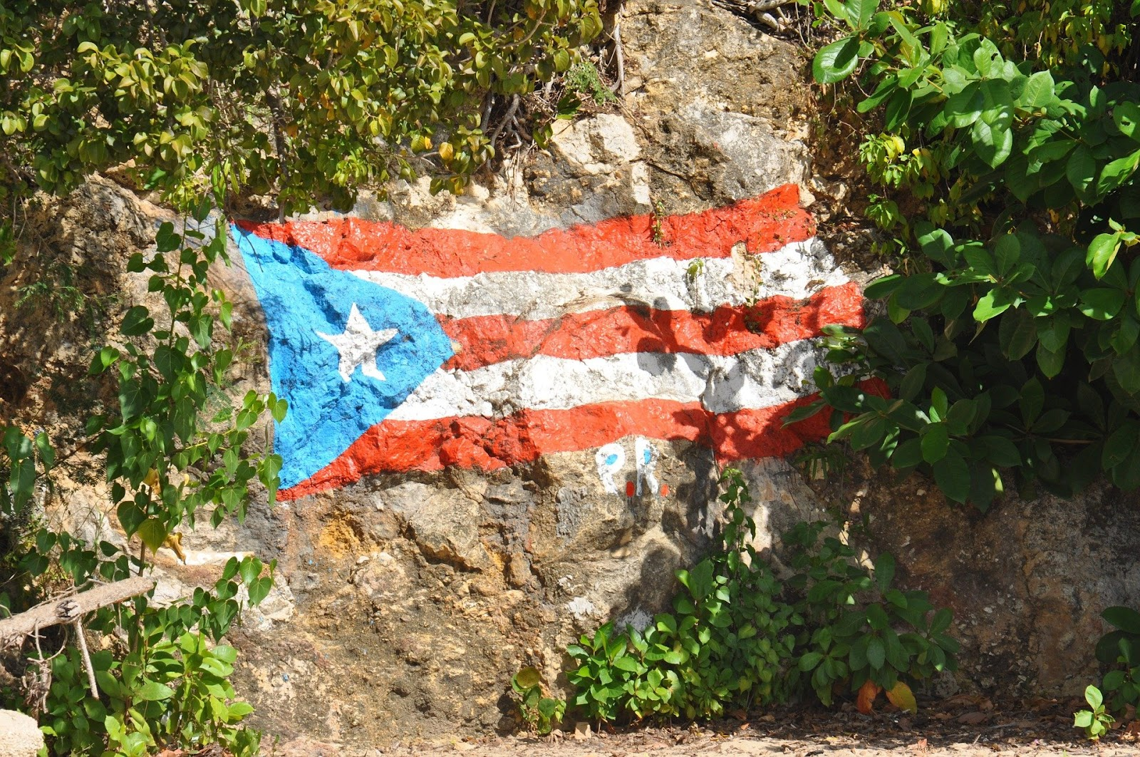 Puerto Rican flag painted on a rock