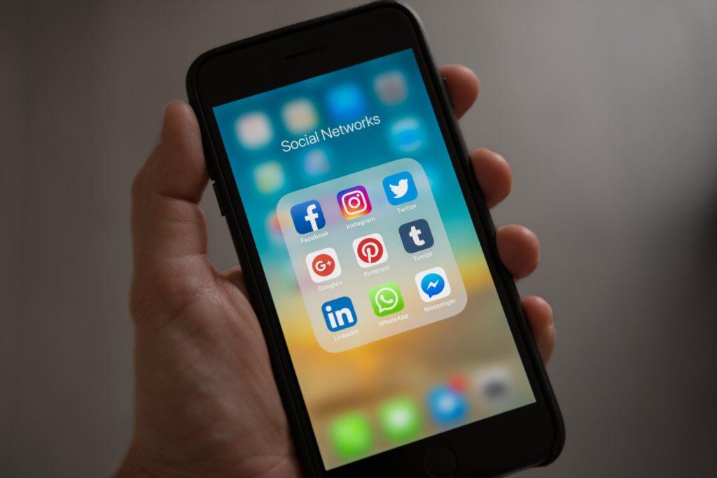 A phone displaying social media icons.
