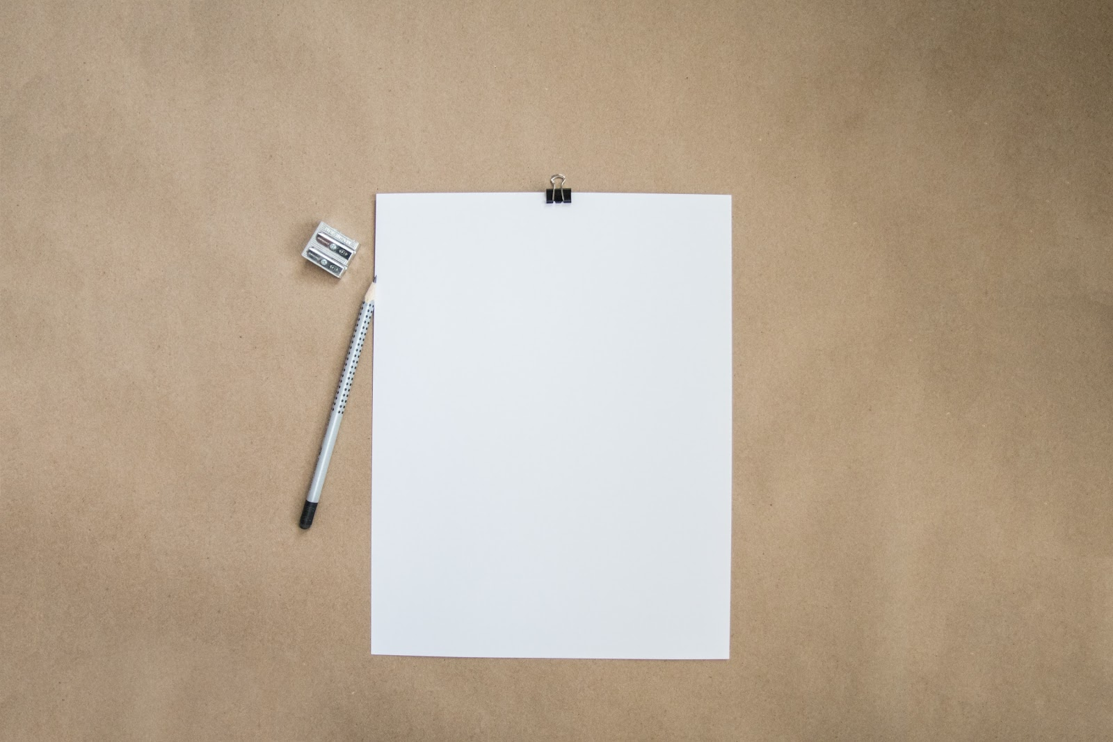 Blank paper with pencil and pencil sharpener