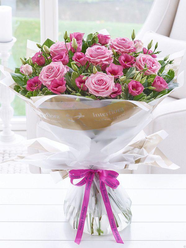 Ảnh có chứa hoa, bó hoa, cây, bàn  Mô tả được tạo tự động