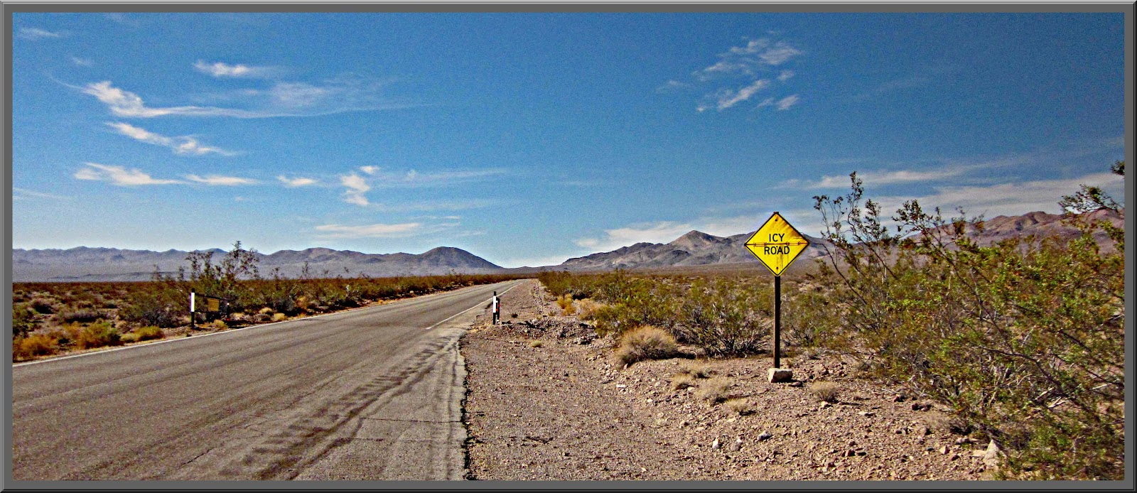 Biking up Dantes View Death Valley - Icy Road sign in death valley
