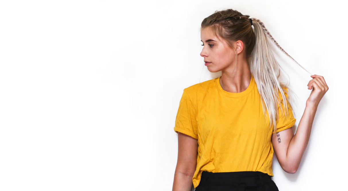 woman in yellow shirt against white background