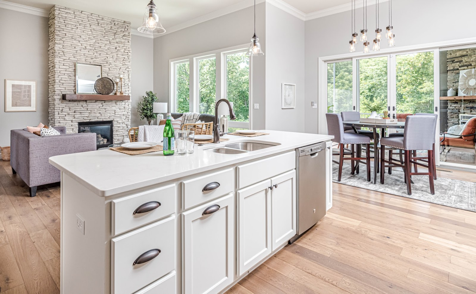 Open plan kitchen for a stylish and minimalist kitchen design; a white kitchen island with built-in features & cabinets
