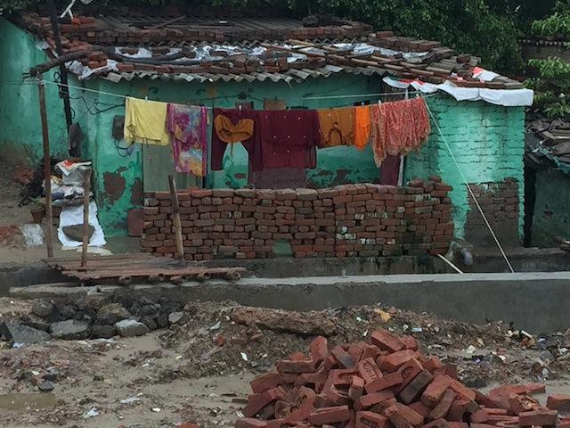 India's latest census reveals a land of paradox, where the largest population of the world's poor live in ragged huts, side-by-side with enormous skyscrapers. Credit: Neeta Lal/IPS